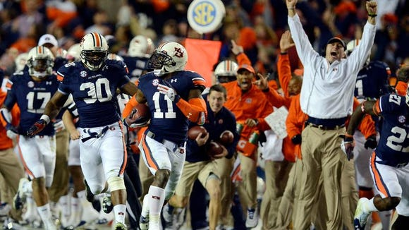 Auburn cornerback Chris Davis returns an Alabama last-second missed field goal 100 yards for a touchdown in the Iron Bowl at Jordan-Hare Stadium on Saturday.