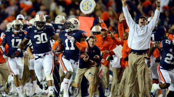 Auburn cornerback Chris Davis returned a missed field goal 100 yards on the Iron Bowl's final play to beat Alabama, 34-28, at Jordan-Hare Stadium.
