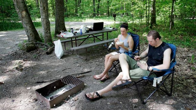 Greg and Leah Enns of Appleton, make breakfast while camping at High Cliff State Park near Sherwood on May 23, 2010.