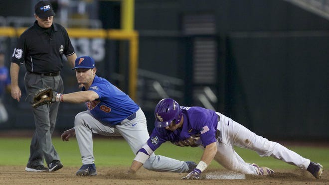 Jun 26, 2017; Omaha, NE, USA; Florida Gators second baseman Deacon Liput (8) can't make the tag against LSU Tigers right fielder Greg Deichmann (7) in the eighth inning in game one of the championship series of the 2017 College World Series at TD Ameritrade Park Omaha. Mandatory Credit: Bruce Thorson-USA TODAY Sports