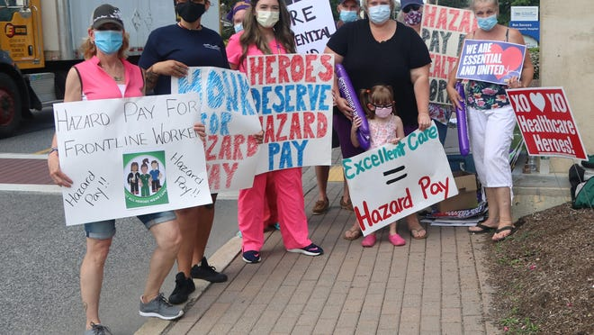 Bon Secours Community Hospital workers picketed a second time for hazard pay. From left: Erika Emigh, Felicia Daddario, Linda O'Connor, Caitlin Rollman, Gordon Emigh,  Irene Stokkeland and her daughter Olivia, Sandra Campbell and on the far right, Carol Dolshu.