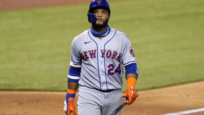 New York Mets' Robinson Cano (24) walks to the dugout against the Miami Marlins, Monday, Aug. 17, 2020, in Miami.