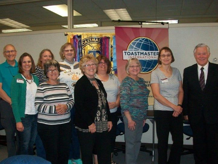 Fond du Lac Toastmasters Club No. 498 poses in front