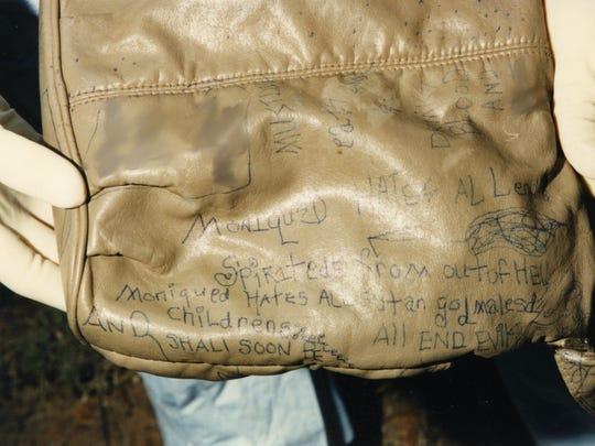 Purse found near a burning car where a woman was found dead in Phoenix in 1997.