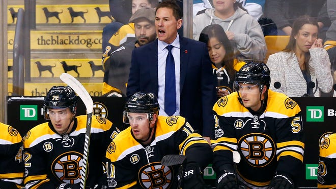 Boston Bruins interim head coach Bruce Cassidy looks on from the bench during the first period against the San Jose Sharks at TD Garden.