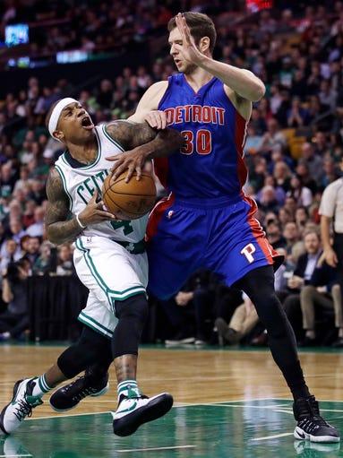 Boston Celtics guard Isaiah Thomas, left, tries to