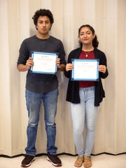 """Alex Hernandez, 16, and Angelina Grimaldo, 16, pose for a portrait with their first place awards for their app, """"Energos"""" as part of The Immokalee Foundation's ENGAGE Summer Academy on July 6, 2017. The six week program taught students to write, code, and ultimately create an app to help satisfy a community need. They were awarded a $500 scholarship each for post-secondary education. Their app helped connect parents and their children with after school activities."""