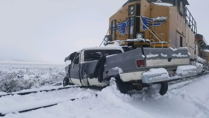 One dead after train collides with truck in Iron County