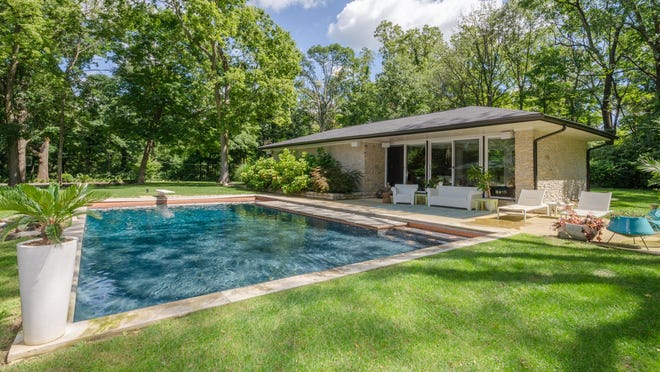 The current owner added a pool and pool house. Many of the rooms in the house overlook the pool.