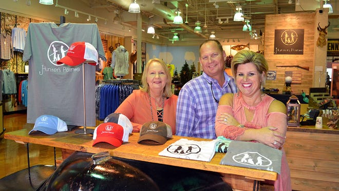 Hunter's Pointe, located at the Outlets of Mississippi at 200 Bass Pro Drive in Pearl, offers casual outdoor wear for men and ladies, T-shirts, home decor and more. Family members, from left, Marge Sills, Eddie Patterson and Twyla Patterson work together making their businesses a success.