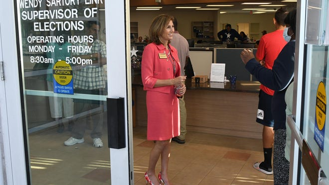 Palm Beach County Supervisor of Elections Wendy Sartory Link (center) answers questions at the Palm Beach County Supervisor of Elections offices on Tuesday, March 17, 2020 in West Palm Beach.