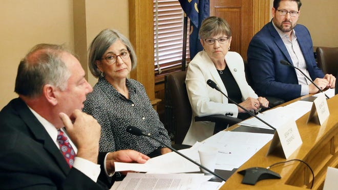 From left, Senate Majority Leader Jim Denning, R-Overland Park, Senate President Susan Wagle, R-Wichita, Gov. Laura Kelly and House Speaker Ron Ryckman, R-Olathe, meet in 2019. Kelly and legislative leaders agreed Tuesday not to pursue another statewide mask mandate.
