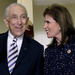 Sen. Frank Lautenberg, 89, the oldest member of the U.S. Senate, shares a laugh with wife Bonnie Englebardt Lautenberg, Friday, Feb. 15, 2013, in Paterson, N.J., as he is introduced to a gathering where he announced plans to retire at the end of his current term.