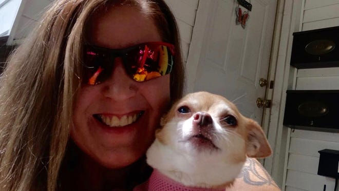 Kristi Sample's dog Chloe was stolen on July 23. The dog was found on the side of a road in Ohio, taken to a dog shelter and adopted out. About a month later, the woman who adopted Chloe gave her back. Sample and Chloe were reunited on Aug. 24.