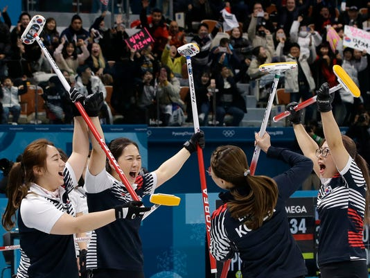 South Korea team jubilates after winning against Japan in the women's curling semi-final match at the 2018 Winter Olympics in Gangneung, South Korea, Friday, Feb. 23, 2018. (AP Photo/Aaron Favila)