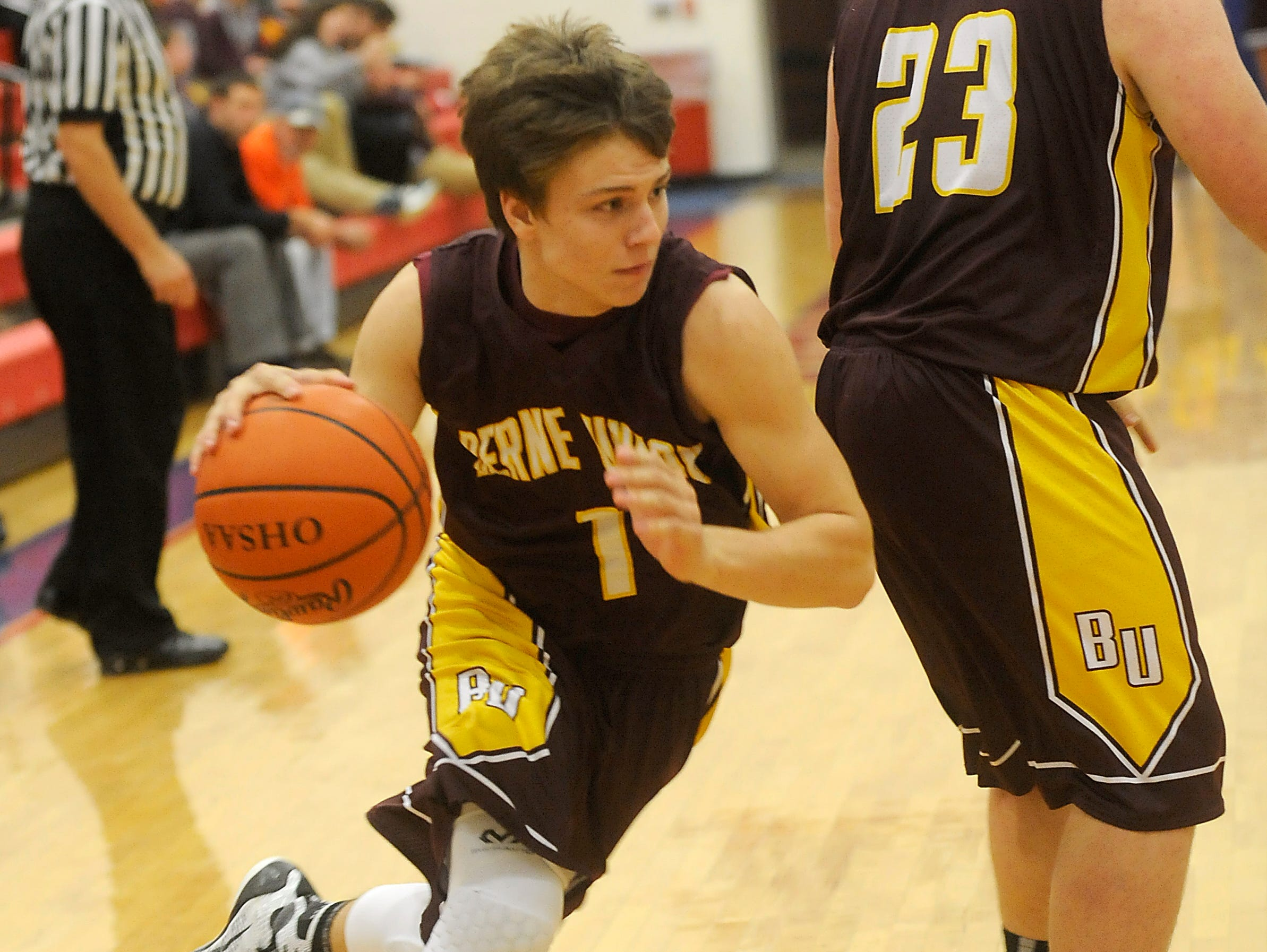 Berne Union's Hunter Mahlerwein runs in to the paint with the ball as teammate Braden Little screens for him against Lakewood on Wednesday, Dec. 2, 2015. The Rockets lost to Lakewood 58-47.