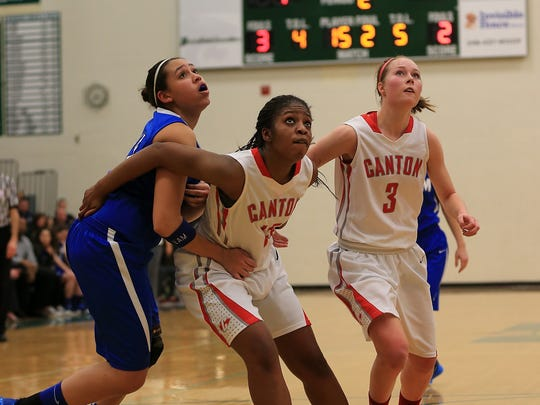 Salem's Maranda Armstead (left) goes up for a rebound against Canton's Alanna Brown (No. 15) and Natalie Winters (No. 3) during the district final.