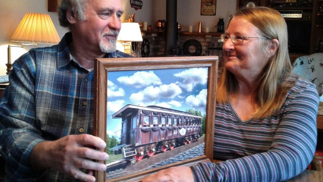 Jerry and Carol Mennenga of Iowa City are among about five core volunteers who spearheaded the building of an authentic replica to the Abraham Lincoln funeral rail car.