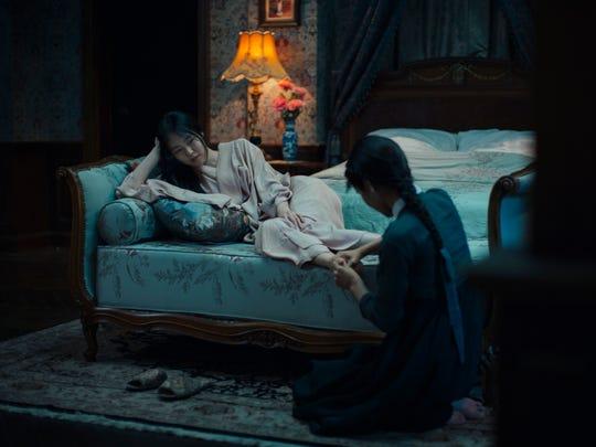 Sookee (Kim Tae-ri) tends to Hideko (Kim Min-hee) in