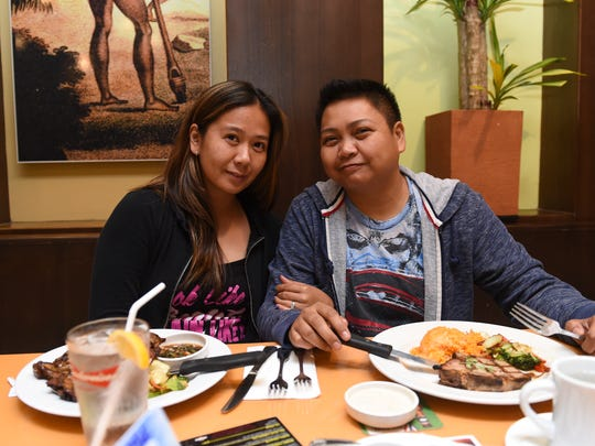 Rhea Soriano , left, and Ched Raboy, right, smile for the camera at the Meskla Bistro/Shock Top Pop-up Craft Event in Hagatna on Feb. 29.