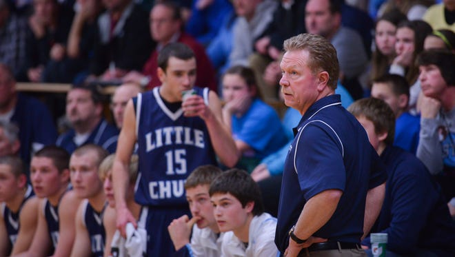 Little Chute's head coach Mickey Martin watches from the sideline during their basketball game against Xavier at Xavier High School in Appleton, Wis. on January 31, 2014. Photo by Graham Washatka for The Post-Crescent