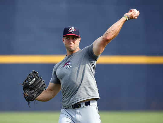 Outfielder Tim Tebow warms up in Trenton on Friday