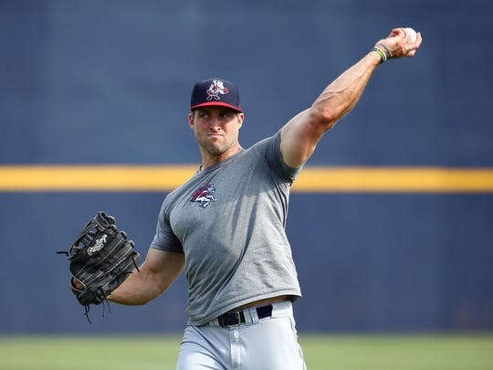 Tim Tebow warms up on June 8 before he and the Binghamton Rumble Ponies played the Trenton Thunder in a three-game series at Arm & Hammer Park.