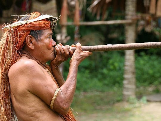 "A native of the Amazonian jungle demonstrates a blow gun in a scene from ""The Amazon,"" the Marlin Darrah movie showing April 15 for the Kiwanis and Rotary Clubs of Door County North's Travel and Adventure Film Series."