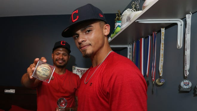 Lenny Torres with his son, Lenny Torres, Jr. at their home in Beacon on June 13, 2018.  Lenny Jr. recently signed with the Cleveland Indians. Lenny Sr. holds Jr's baseball from hitting his first home run.