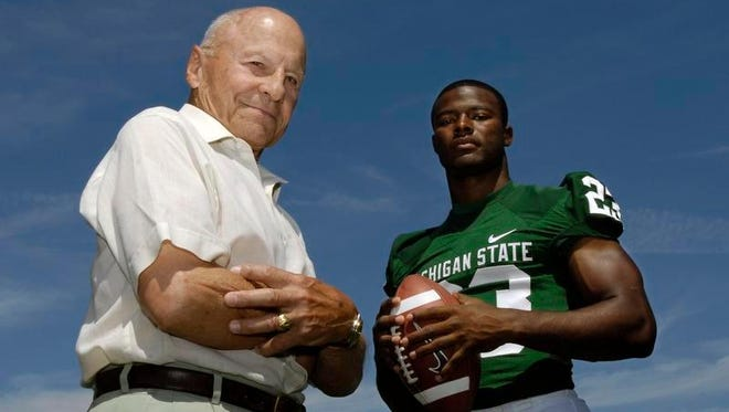 George Guerre with former Spartan tailback Javon Ringer in 2008.