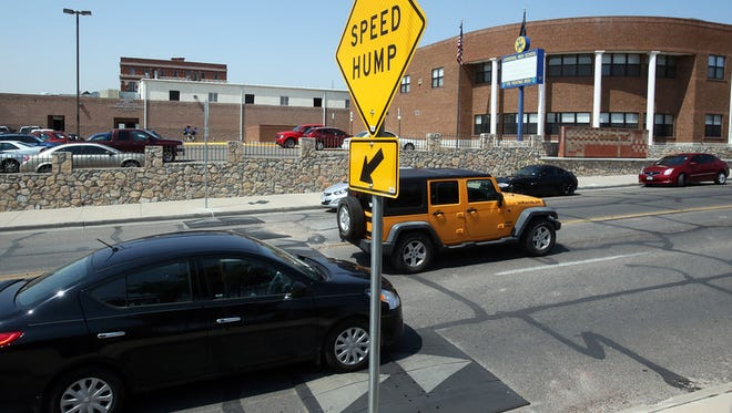 """""""Drivers slow down as they make their way over speed bumps placed along N. Stanton in front of Cathedral High School Monday near downtown El Paso. """""""