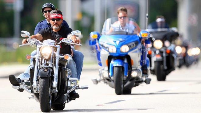 Bikers travel east on Gladiolus Drive in Fort Myers during the March of Dimes 14th annual Bikers for Babies Event and Motorcycle Ride on Sunday. 1,500-plus bikes rode from Collier County to Six Bends Harley on Daniels for the event.