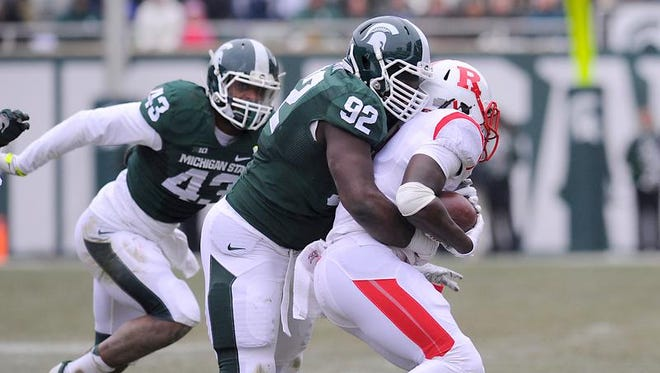 MSU's Joel Heath hits Rutgers running back Josh Hicks in East Lansing Saturday 11/22/2014.