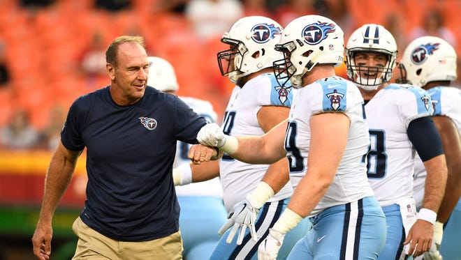 Tennessee Titans head coach Mike Mularkey greets his players before the start of a preseason game against the Chiefs Arrowhead Stadium Thursday, Aug. 31, 2017 in Kansas City, Mo.