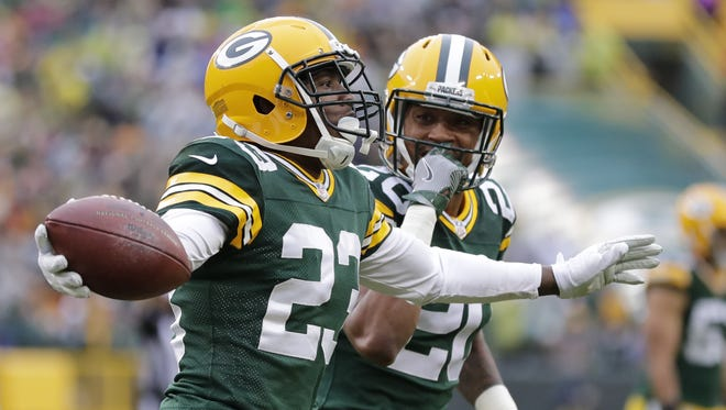 Green Bay Packers cornerback Damarious Randall (23) celebrates his interception with cornerback Kevin King (20) in the first half Sunday, October 22, 2017, at Lambeau Field.