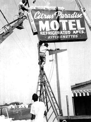 The dangers of installing large-scale neon is reflected in the 1950s photograph of the installation of the Citrus Paradise Motel sign at 1045 East Main Street. It is believed that Paul Millet is the one precariously perched atop the A-frame ladder.