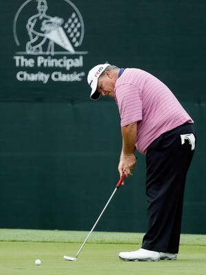 Guy Boros putts on the 17th green during the final round of the Champions Tour's Principal Charity Classic golf tournament, Sunday, June 7, 2015, in Des Moines, Iowa. (AP Photo/Charlie Neibergall)