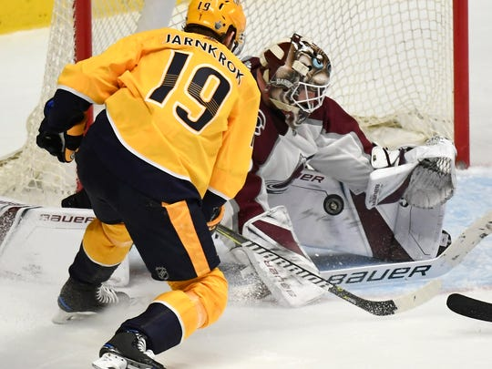 Colorado Avalanche goaltender Andrew Hammond (35) stops a shot by Nashville Predators center Calle Jarnkrok (19) during the second period in game 5 of the first round NHL Stanley Cup Playoffs at the Bridgestone Arena Friday, April 20, 2018, in Nashville, Tenn.