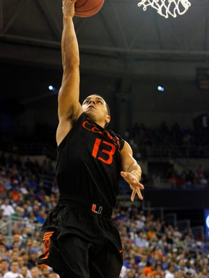 Miami Hurricanes guard Angel Rodriguez (13) shoots a layup against the Florida Gators during the second half at Stephen C. O'Connell Center. Miami Hurricanes defeated the Florida Gators 69-67.