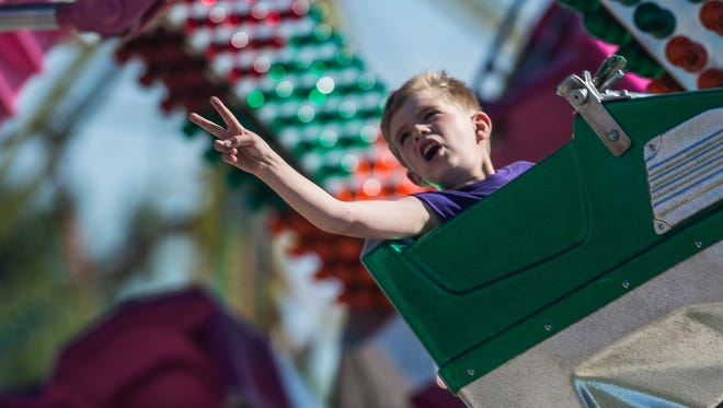 A boy rides the Orbiter at the 2017 Wayne County 4H Fair at the county's fairgrounds on Tuesday, June 21, 2017.