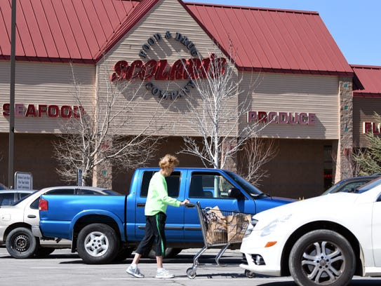 A shopper heads to her vehicle at the Yerington Scolari's.