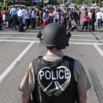 Police face off with protesters Wednesday in Ferguson, Missouri.