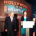 Iowa Lt. Gov. Kim Reynolds speaks at a news conference Monday announcing a new exhibit focusing on Iowa's history in movies. She is flanked by Gov. Terry Branstad and Mary Cownie, director of the Iowa Department of Cultural Affairs.