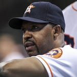 Aug 11, 2014; Houston, TX, USA; Houston Astros manager Bo Porter (16) watches from the dugout during the fourth inning against the Minnesota Twins at Minute Maid Park.