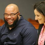 Gerard Richardson shares a laugh with his Innocence Project attorney Vanessa Potkin prior to a hearing, Tuesday, Dec. 17, 2013, in Somerville, N.J. Richardson was exonerated after being imprisoned for 20 years for a murder he did not commit.