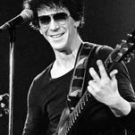 Lou Reed performs at The Bottom Line in 1977 in New York City.