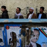 Afghan residents wishing to vote line up outside a local polling station in Kabul on April 5.