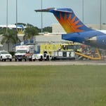 Emergency crews at the plane where a flight attendant was transported after suffering a gash to her face due to turbulence.
