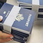 Passports are spread out before the information is applied to them at the New Orleans Passport Agency on July 17, 2007.