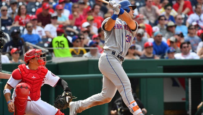 Apr 29, 2017; Washington, DC, USA; New York Mets left fielder Michael Conforto (30) hits a solo home run against the Washington Nationals during the eighth inning at Nationals Park. Mandatory Credit: Brad Mills-USA TODAY Sports